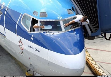 How does a pilot clean a window from the outside on a