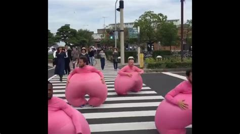 Guys in pink suits bouncing   FunnyDog