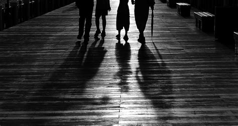 Silhouette of 4 Person Walking · Free Stock Photo