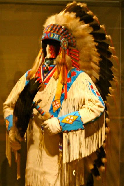 Traditional Native American clothing and headdress display