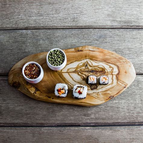 olive wood chopping/cheese board by the rustic dish