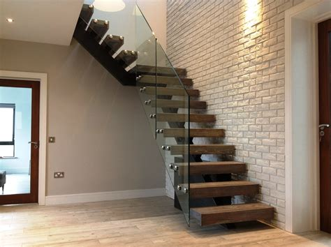 Steel spine stairs - Designed and Fitted by AJD for