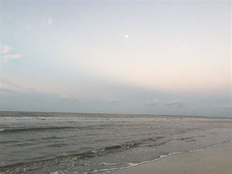 Sharing a beach sunrise with the moon! www